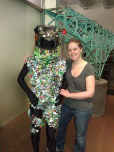 The author with a suit made of recycled plastic consumer cards – credit, debit, coffee, transit, health insurance, and auto. Each of the 3,063 plastic cards represents 3 million humans, as the population is predicted to grow to 9.6 billion by 2062.