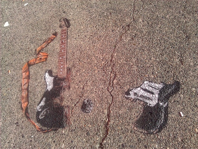 A street stencil of a smashed electric guitar is Jonathan's shout-out to legendary Seattle artist Jimi Hendrix. Photo credit: Louisa Gaylord