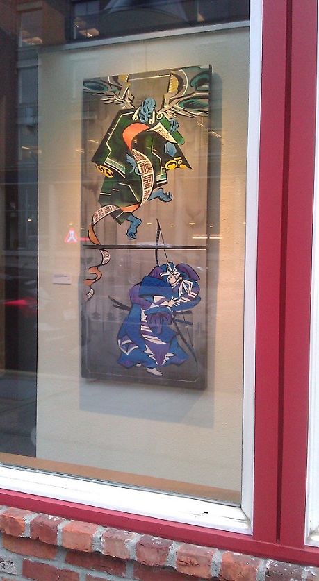 Jonathan's art on display in the window of Art Xchange on 1st and King St. Photo credit: Louisa Gaylord